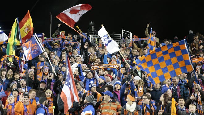 Fans in The Bailey section support FC Cincinnati in the second half during the USL soccer game between the Charlotte Independence (1-1-0) and FC Cincinnati (1-1-0), Saturday, April 9, 2016, at Nippert Stadium in Cincinnati. FC Cincinnati won 2-1.