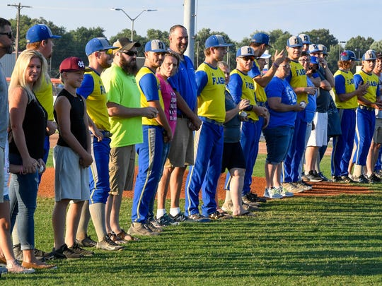 The Henderson Flash players and their hosts introduced on the field before the game as the Henderson Flash plays the Dubois County Bombers in the Ohio Valley League playoffs at B.T. Wayne Field in Henderson Saturday, July 21, 2018.