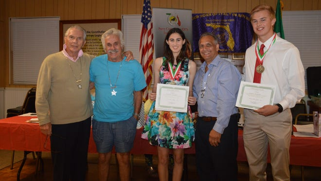 Dr. James L. Casale, scholarship committee chair, Joe Milazzo, scholarship committee, Caitlin Gualtieri, (Dwyer High School) recipient, Joe Sconzo, president of Sons and Daughters of Italy in America/Perry Como Lodge and Grant Stelmack,(Jupiter High School) recipient.