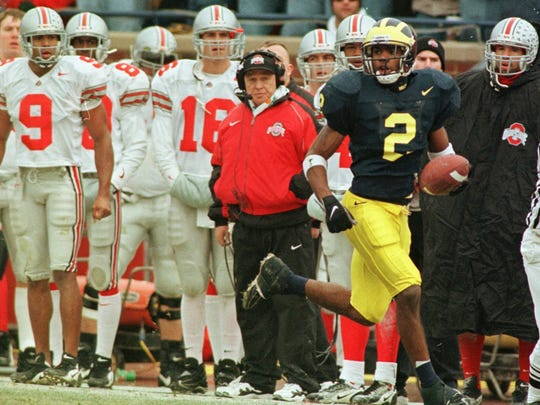 The Ohio State bench looks on as Michigan's Charles Woodson returns a 78-yard punt return for a touchdown during the second quarter at Michigan Stadium in Ann Arbor, Saturday, Nov. 22, 1997.