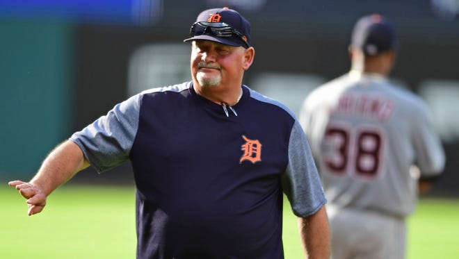 Detroit Tigers pitching coach Chris Bosio reacts after a visit to the mound during the first inning against the Cleveland Indians, Saturday, June 23, 2018, in Cleveland.