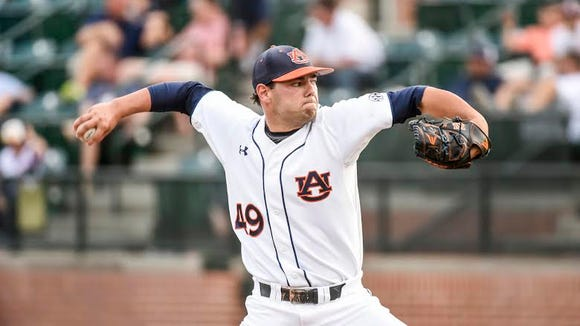 Auburn junior RHP Cole Lipscomb throws a complete game