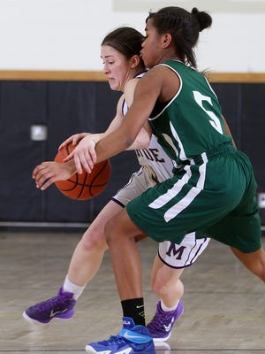 Monroe's Erica Junquet drives on East Brunswick's Shanelle Colmon.