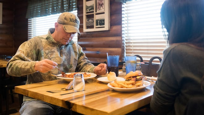 """Evan McCarthy and Rebecca Evans have dinner at Chapmans on Monday, Feb. 5. McCarthy dines at the restaurant almost every Monday for the complimentary spaghetti. """"There's a large concentration of veterans here,"""" said McCarthy. """"As a community outreach, it is a nice gesture. I'm grateful for that."""" McCarthy was in the Navy 1996-2001 and Air Force 2005-2011."""