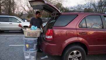 Former Economy Inn residents move out of Nicholtown church back into motels