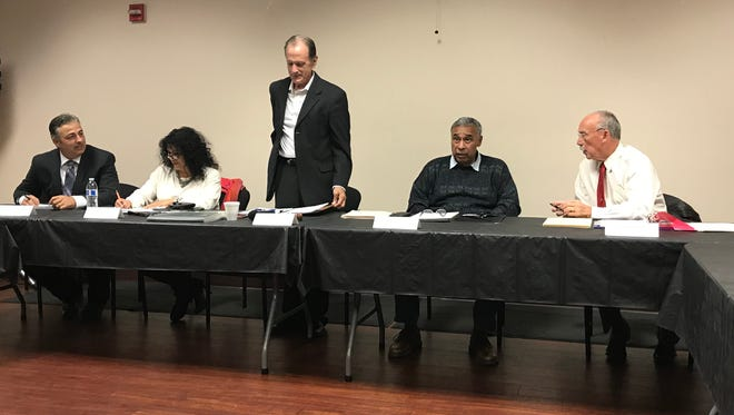 Kevin Northcraft, middle, speaks during the Tulare hospital board meeting on Wednesday. From left to right, Xavier Avila, Senovia Gutierrez, Mike Jamaica and Stephen Harrell.