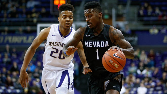 Wolf Pack guard Marcus Marshall dribbles past Washington guard Markelle Fultz on Sunday.