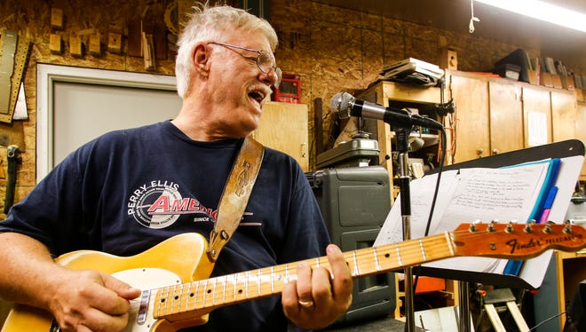 Playing his 1961 vintage Telecaster, 75-year-old Roger Benham belts out a tune with his band The Blue Echoes.