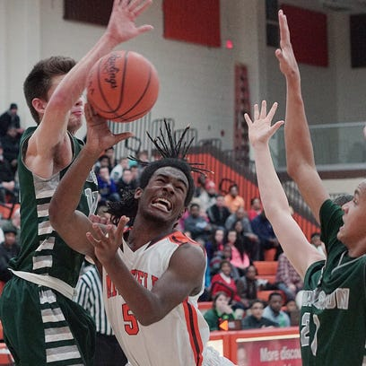Mansfield Senior's Jornell Manns throws the ball up