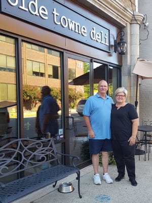 Richard and Melissa Malone stand outside the Olde Towne Deli in Salisbury. The couple opened the eatery in the summer of 2016.