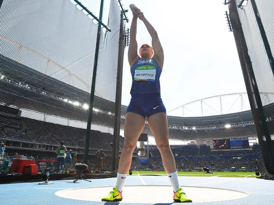 Croatia's Sandra Perkovic struggled to qualify in the wind and rain Monday, but made Tuesday's final count, winning gold in the discus.