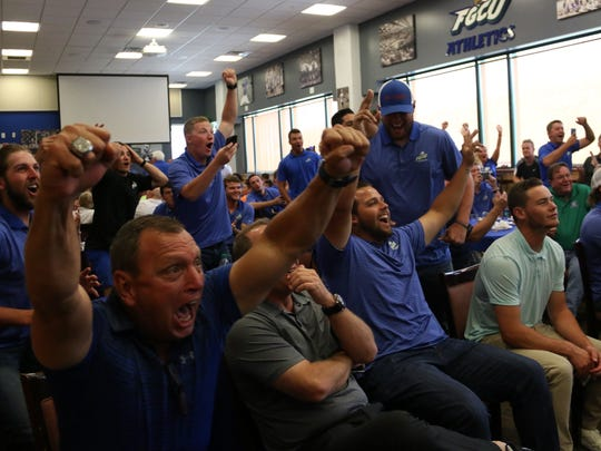 Founding head coach Dave Tollett (left) and the FGCU baseball team react to hearing their name called during program's NCAA watch party in the Alico Arena Hospitality Suite on Monday, May 29, 2017. The No. 2-seeded Eagles (42-18) will face No. 3 Michigan (42-15) on Friday in the Chapel Hill region.