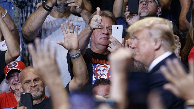 The crowd looks to President Donald Trump as he arrives for a rally, Thursday, Aug. 2, 2018, at Mohegan Sun Arena at Casey Plaza in Wilkes Barre, Pa.. (AP Photo/Carolyn Kaster)