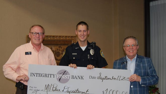 Integrity First Bank recently donated $1,000 to the Mountain Home Police Department toward the purchase of a patrol car to be used by Patrolman Philip Gonten. Shown are, from left, John Reding, IFB senior vice president; Gonten, MHPD patrolman, and Joe Miles, IFB president.