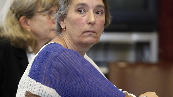 FILE - In this Sept. 17, 2012 file photo, Annette Smith watches in court during a conference hearing on the recount of the Progressive Party race for governor in Montpelier, Vt. The Vermont attorney general launched a criminal investigation in January 2016 to determine whether Smith, an environmental activist, has been practicing law without a license. (AP Photo/Toby Talbot, File)