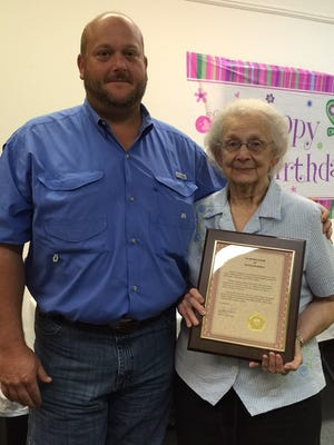 A surprise 90th birthday party was held Monday for Kathleen Bogle at Lumberton Public Library. Lamar County District 2 Supervisor Warren Byrd presented her with a framed document recognizing her service to Lumberton and Lamar County.