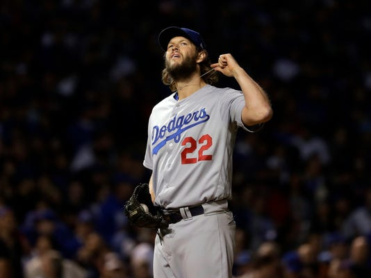 Los Angeles Dodgers starting pitcher Clayton Kershaw (22) reacts after giving up a home run to Chicago Cubs' Kris Bryant during the fourth inning of Game 5 of baseball's National League Championship Series, Thursday, Oct. 19, 2017, in Chicago. (AP Photo/Matt Slocum)