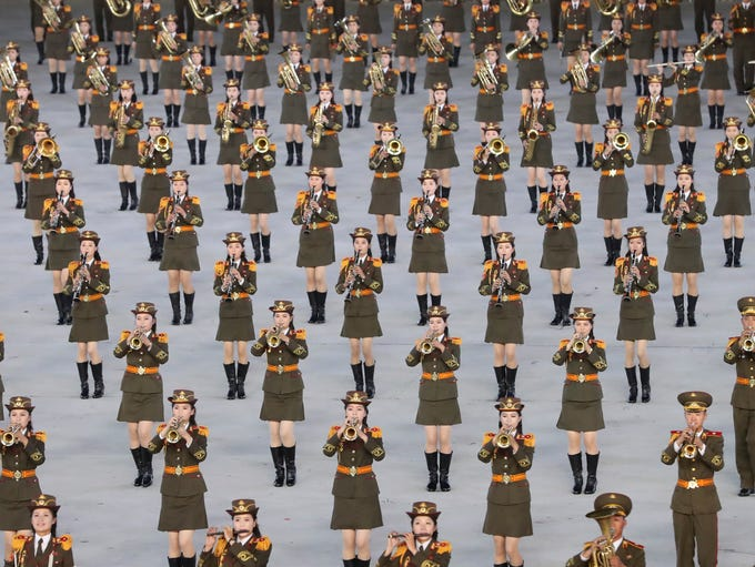 North Koreans perform during an event, as part of the