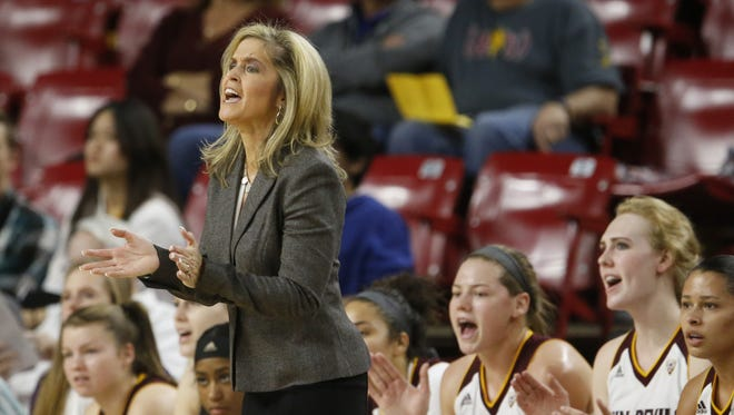 Arizona State University head coach Charli Turner Thorne and the bench cheer on their team during the first game of the ASU Classic tournament against Boston University at Wells Fargo Arena in Tempe on December 3, 2016.