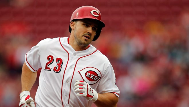 Cincinnati Reds left fielder Adam Duvall (23) rounds the bases after hitting a solo home run in the bottom of the first inning of the MLB National League game between the Cincinnati Reds and the Miami Marlins at Great American Ball Park in downtown Cincinnati on Friday, May 4, 2018.