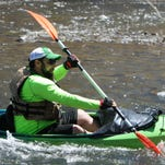 Left to right Ben Myers, 30, Kristen Myers, 27, of Melville, and Michelle Donohue, 32 of Wappingers Falls paddle through some rapids during the Wappingers Creek Water Derby on April 25, 2015.