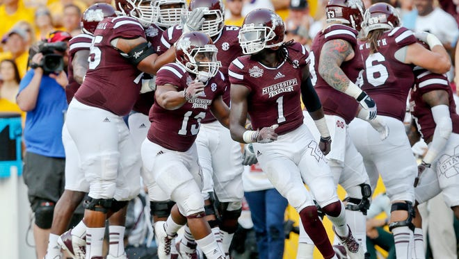 Sep 20, 2014; Baton Rouge, LA, USA; Mississippi State Bulldogs wide receiver De'Runnya Wilson (1) celebrates with teammates after scoring a touchdown against the LSU Tigers during the first quarter of a game at Tiger Stadium. Mandatory Credit: Derick E. Hingle-USA TODAY Sports
