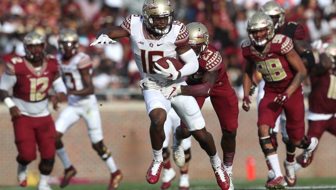 FSU's Tre' McKitty tries to break away from Hamsah Nasirildeen during the Garnet and Gold Spring Game at Doak Campbell Stadium on Saturday, April 14, 2018.