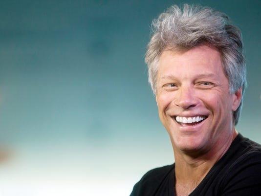 Musician Jon Bon Jovi laughs during media interviews in Vancouver, British Columbia, Saturday, Aug. 22, 2015. The singer is scheduled to play Rogers Arena Saturday night with Kings of Suburbia after their performance at Stanley Park was canceled. The City of Vancouver said earlier this week that the promoter, Paper Rain, didn't have the required permits for the group to perform at the park.