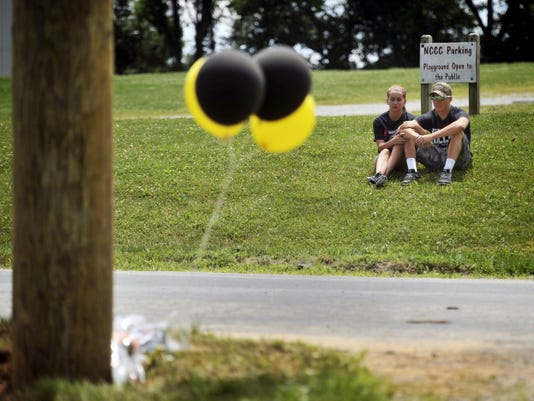 Red Lion class of 2015 graduate Cody Stern and girlfriend, Red Lion junior Lindsay Wilhelm, look over the site of a crash that killed Stone Hill and Nick Mankin on Tuesday on Slab Road.