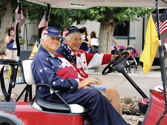 Bill Armendariz — Headlight Photo   The Kretek Twins, Gertrude and Geraldine are ready for a parade at the drop of a hat. Here, the sisters ride in style in a golf cart decorated for the Fourth of July Parade and Community Picnic held this weekend. The parade rolled through Silver Avenue en route to the Luna County Courthouse Park.