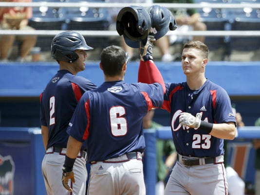 Florida Atlantic's Brendon Sanger, right, seen here after hitting a recent homer, was drafted in the fourth round of Major League Baseball First-Year Player Draft on Tuesday. Sanger attended Dallastown schools until he was 13. (AP Photo/John Raoux)