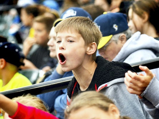 A young fan cheers on the York Revolution during a game at Santander Stadium. The Revs' attendance was down 3 percent this season, with a per-game average of 3,823 fans.