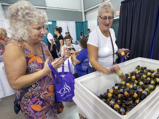 """Joyce Smith, left, described the 50plus EXPO at the York ExpoCenter as being like Halloween, referring to all the free goodies along the way. Her sister, Jane Kline, meanwhile, said """"it's fun getting older."""" The sisters, who live in Dover Township, visited the event for the first time on Wednesday."""
