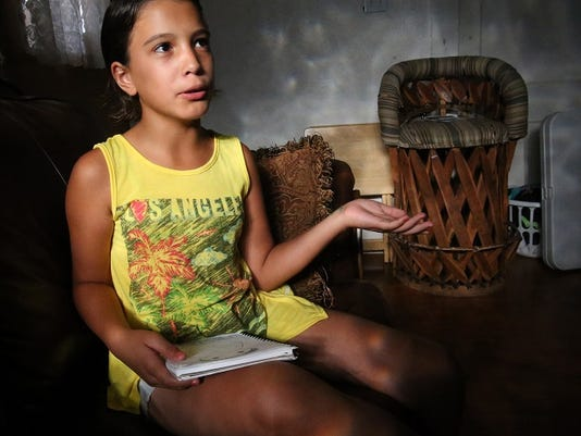 Rudy GutierrezÑEl Paso Times Sarah Montejano, 9, talks about her drawings in her Central El Paso home. Montejano has experienced relief from epileptic seizures with help from certain medications.