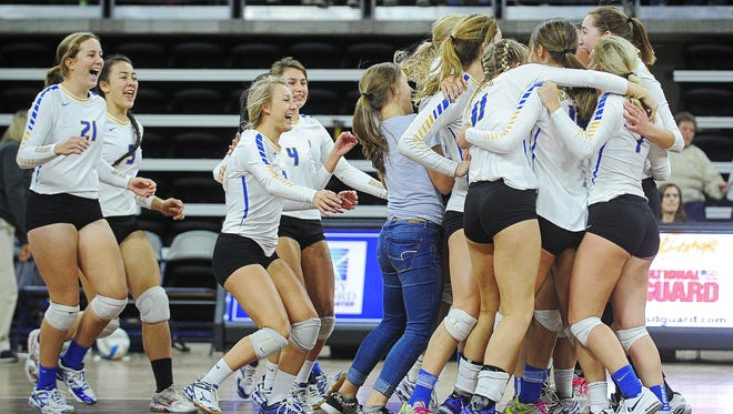Aberdeen Central players react after defeating Brandon Valley in the South Dakota State High School Class AA championship volleyball match Saturday, Nov. 21, 2015, at the Denny Sanford Premier Center in Sioux Falls.