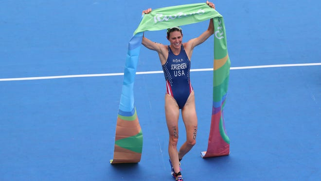 Gwen Jorgensen of the United States celebrates after winning gold in the women's triathlon during the Rio 2016 Summer Olympic Games at Fort Copacabana.