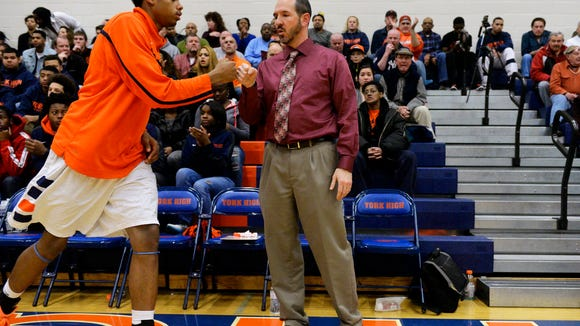 William Penn boys' basketball coach Troy Sowers fist-bumps Jahaire Wilson during player introductions before the Bearcats game against Chester on Dec. 20. (Chris Dunn - Daily Record/Sunday News)
