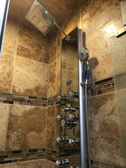 A 2 Ruidoso Redheads master bathroom features a shower