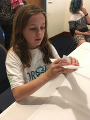 Kat Kenton, 10, of Frederick, Md., molds foam into
