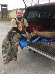 Dakota Stine, St. Thomas poses with his 8-point deer