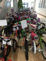 Donated bicycles wait to be loaded onto a truck at