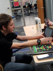 Devin McDonough,19, explains a video game to teachers.