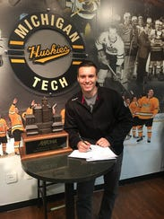 Matt Roy is all smiles after signing a two-year entry