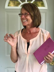 Sandra Bannister shows off the keys to her Habitat