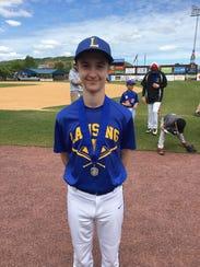 Zackary Sperger, 12, of Lansing, shows off his medal