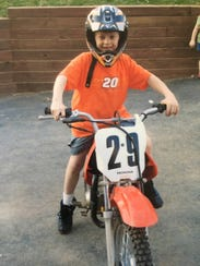 Andrew Povall, as a small child, riding his dirt bike.