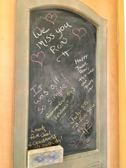 This chalkboard at the Savage home in Milford includes