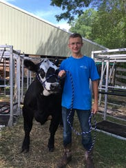 Hunter Richards, 15, poses with his steer, Jackson.