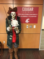 A pirate figure stands at the doorway to Mike Leach's