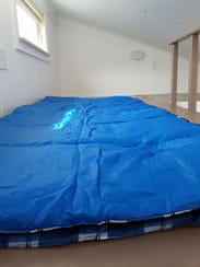 A sleeping bag on a loft in the tiny home.